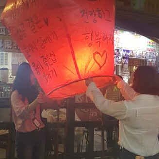 Took pictures of some tourist happily setting their lantern afloat.